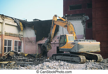 Hydraulic demolition crane dismantling school building.