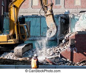 Hydraulic Excavator Demolition - Cement dust spills from the...