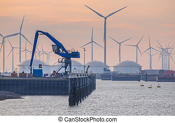 Hydraulic Harbor Crane in the port of Eemshaven with oil...