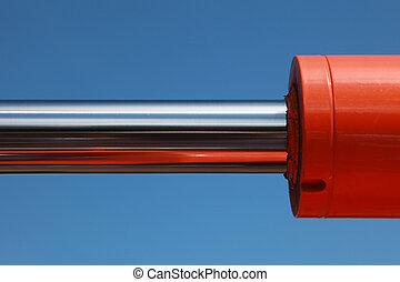 Hydraulic parts of an excavator over blue sky