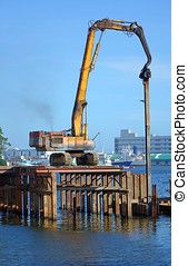Hydraulic Pile Driver in Action