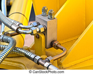 hydraulic tubes - photo of hydraulic tubes against yellow
