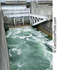 Hydro control structure weir with flow passing underneath causing a violent turbulence discharge of white water