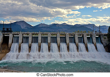 Hydro dam with spillway in the mountains
