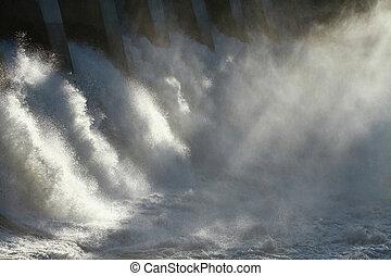 Hydro Dam Spillway - The sun dramatically backlighting the...