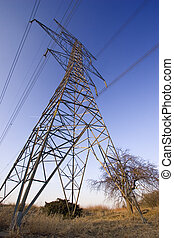 Low wide-angle view of hydro power line tower.