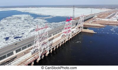 hydro power plant on the river, aerial shooting from the...