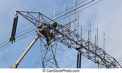 Hydro Worker Climbs Down Ladder - A hydro worker climbs down...