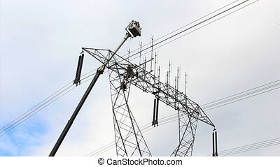 Hydro Workers Working On Power Line - A group of dedicated...