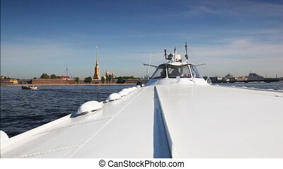 Hydrofoil vessel Meteor floats Neva River to bank with Peter and Paul Fortress