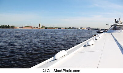 Hydrofoil vessel Meteor stands in middle of Neva River, far away Peter and Paul Fortress