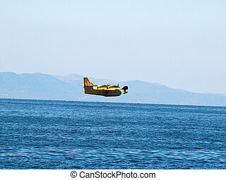 Hydroplane flying over sea