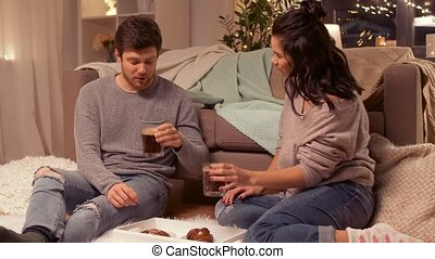 happy couple drinking coffee at home