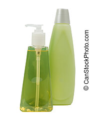 Green color conditioning shampoo in bottle and soft soap in dispenser; isolated, clipping path included
