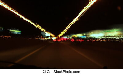 Timelapse clip assembled from photographic stills. Highway driving with a quick turnaround at an exit. All logos removed and/or blurred. QEW highway. Toronto, Ontario, Canada.