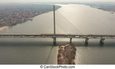 Hyperlapse. Bridge with trafic over the river aerial drone...