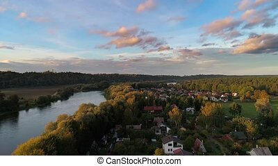 hyperlapse flight over river and forest at evening