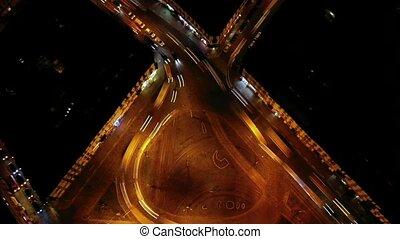 Hyperlapse of night city traffic on stop street intersection...