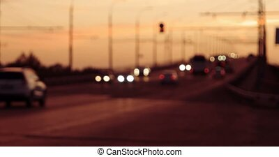 hyperlapse of overpass with blurred cars in sunset time of...