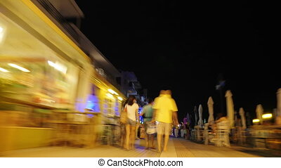 Hyperlapse of people on the streets in night resort city