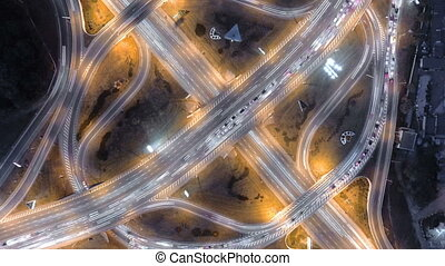 Hyperlapse timelapse of night city traffic. vertical aerial view.