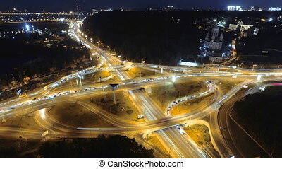 Hyperlapse timelapse of night city traffic. Kiev, Ukraine. vertical aerial view.
