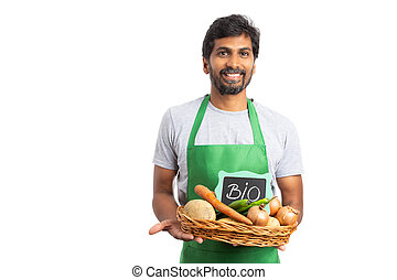 Hypermarket employee holding grocery basket - Indian...