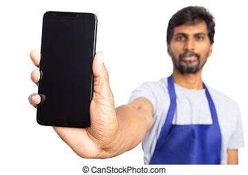 Hypermarket employee presenting touchscreen smartphone
