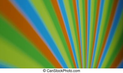 Hypnotic spinning pinwheel - colourful strips. Optical...