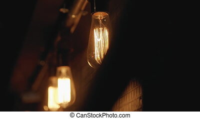 Hypnotic view of night bulb outside the house. It creates...