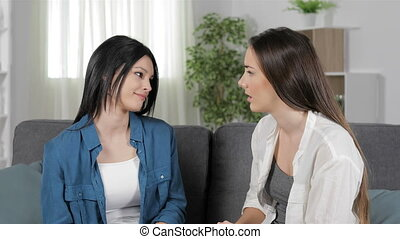 Hypocrite woman reconciling and hugging her friend