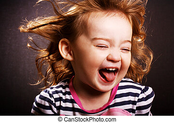 Hysterical little girl - An adorable little girl laughing...
