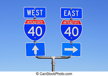 Interstate I 40 east and west road signs with blue sky background