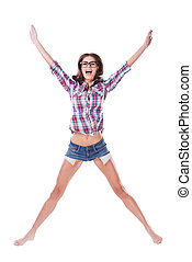 I am a star! Full length of attractive young woman in glasses and funky wear jumping and smiling while being isolated on white background