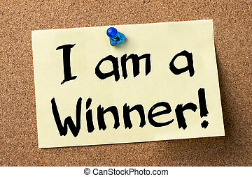 I am a Winner! - adhesive label pinned on bulletin board