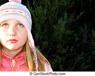 I am bored - Portrait of a young girl in a warm winter hat...