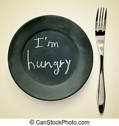 I am hungry - picture of a fork and a plate painted as a...