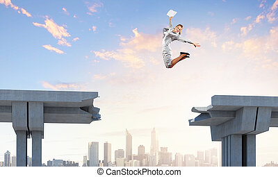 Young woman jumping over a gap in the bridge as a symbol of risk