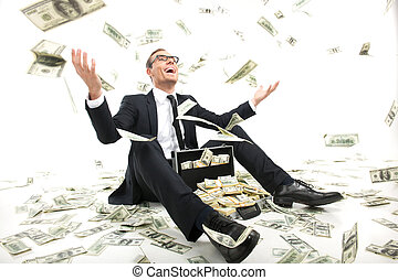 I am rich! Happy young businessman in formalwear throwing...