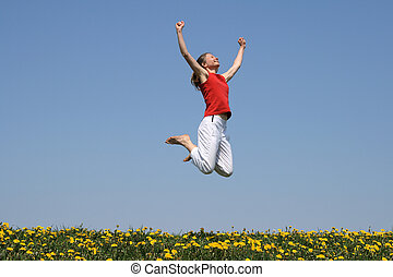 I am the winner! Smiling young woman jumps with her arms ...
