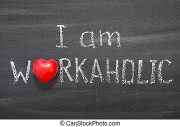 I am workaholic phrase handwritten on blackboard with red heart symbol