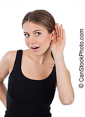 Woman curious trying to listen something, isolated on white