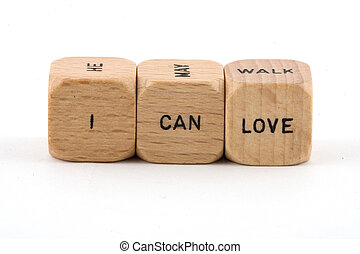 I Can Love phrase created using wood blocks shot against a ...