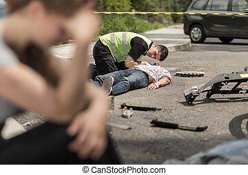 I can't hear his breath - paramedic helping on street man...
