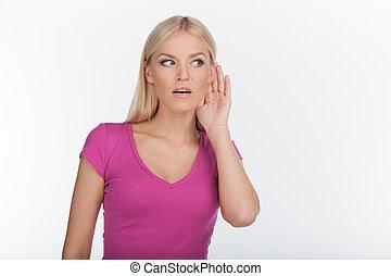 I can't hear you. Beautiful young woman listening gossips ...