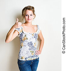 I confirm. - Friendly fashionable young blond woman showing...