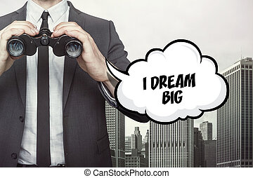 I dream big text on speech bubble with businessman holding binoculars