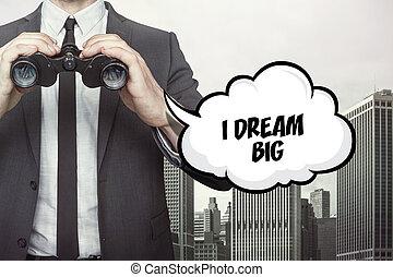 I dream big text on speech bubble with businessman holding binoculars