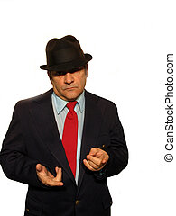 ,Man in a suit, with a hat, could be a businessman, or a mobster, over white