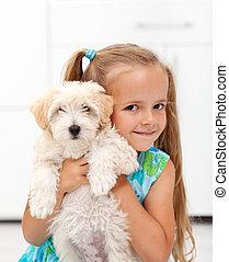 I got a little doggy - happy little girl hugging her pet